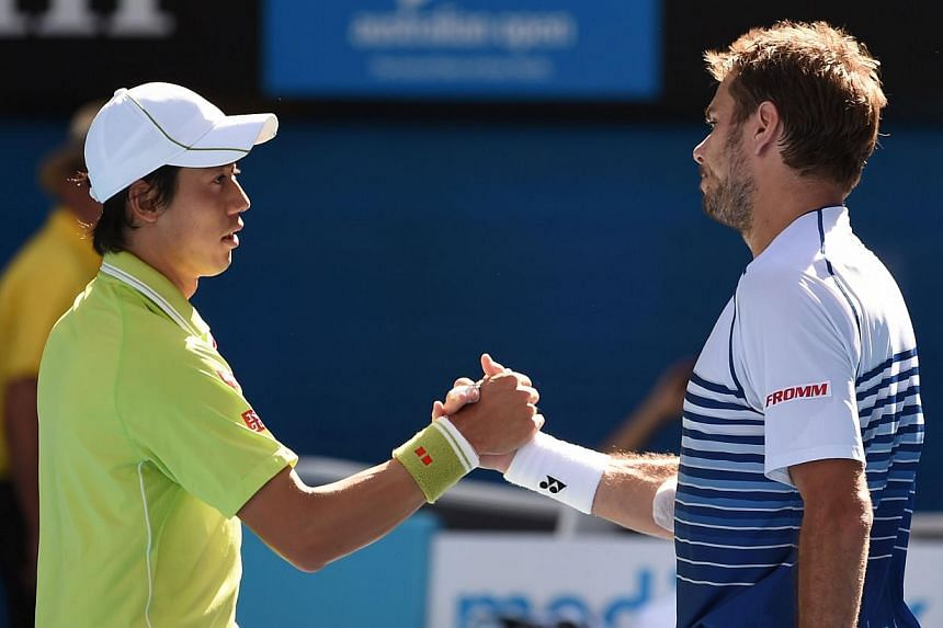 Switzerland's Stanislas Wawrinka (right) shakes hands as he celebrates after victory in his men's singles match against Japan's Kei Nishikori (left) on day ten of the 2015 Australian Open tennis tournament in Melbourne on Jan 28, 2015. -- PHOTO: AFP