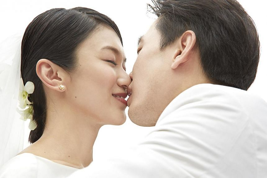 The couple got hitched on Sept 9 last year, after dating for a year. -- PHOTO: MEDIACORP