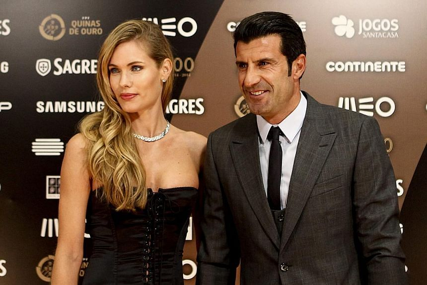 Former Portuguese footballer Luis Figo (right) and wife, Swedish model Helen Svedin, arriving at the casino of Estoril for the Quinas de Ouro gala, in Estoril, Portugal, on Jan 14, 2015.  -- PHOTO: EPA