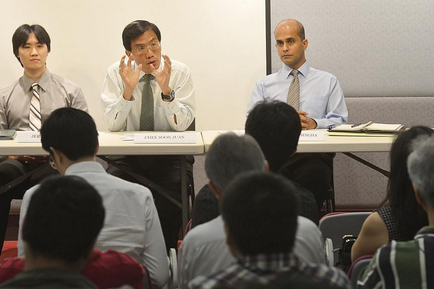 Singapore Democratic Party (SDP) chief Chee Soon Juan (centre) presenting the opposition party's population plan, together with Jeremy Chen (left) and Vincent Wijeysingha,on Feb 14, 2013. Mr Chen, who helped draw up some of the SDP's policies