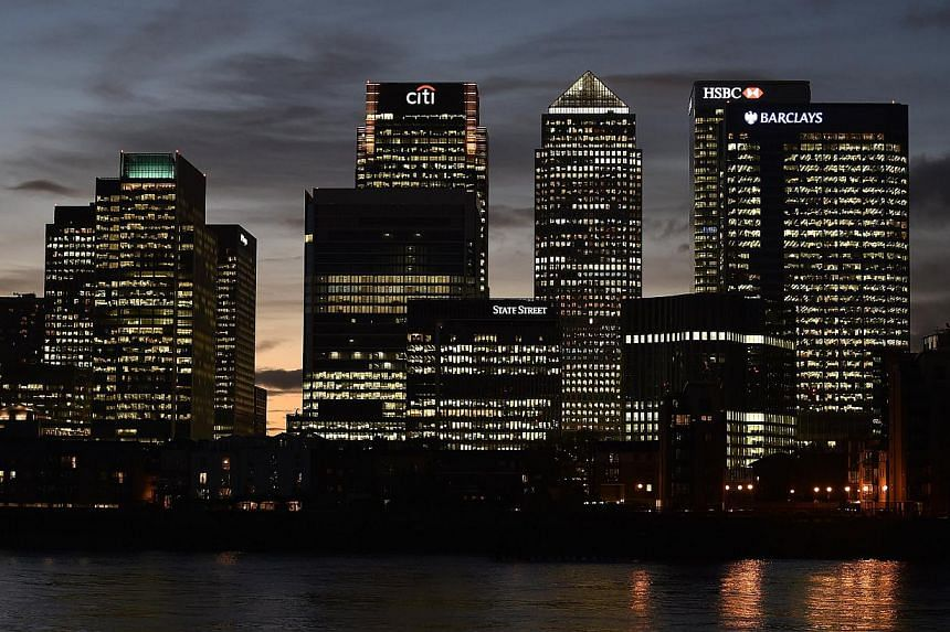 Qatar looked to have won a drawn-out bid to buy London's Canary Wharf on Wednesday after the owner of the landmark office quarter said its main shareholders favoured a sale.-- PHOTO: REUTERS
