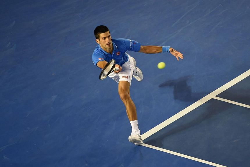 Serbia's Novak Djokovic plays a shot during his men's singles match against Canada's Milos Raonic on day ten of the 2015 Australian Open tennis tournament in Melbourne on Jan 28, 2015. -- PHOTO: AFP
