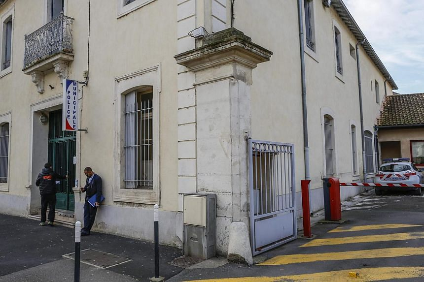 People standing outside the police station in the centre of Lunel, southern France, on Jan 27, 2015. -- PHOTO: EPA