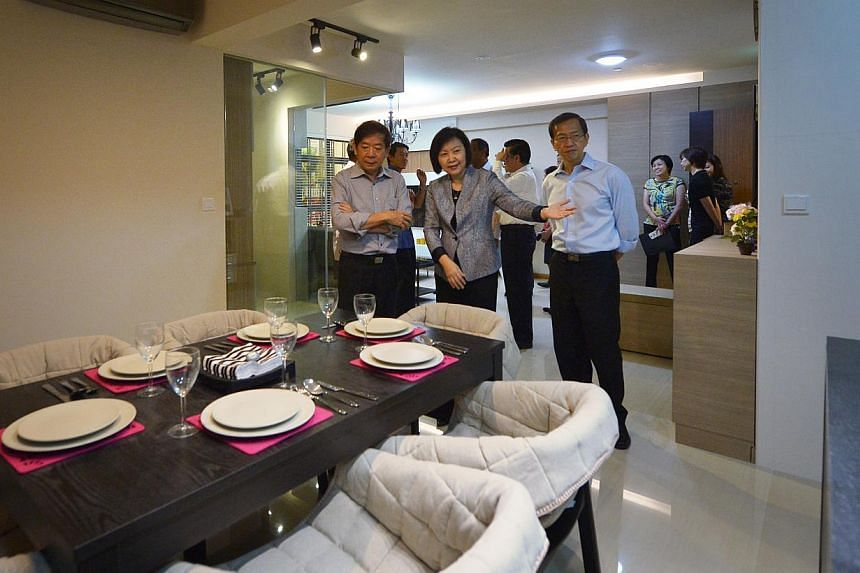 Minister for National Development Khaw Boon Wan (left) visiting the Housing Board's new show flats which were launched on Jan 28. -- ST PHOTO: ALPHONSUS CHERN