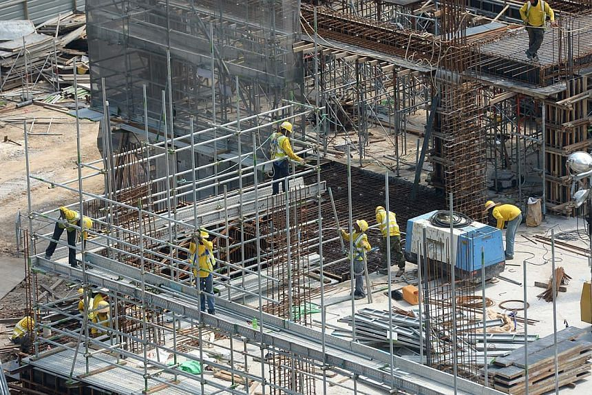 The Manpower Ministry has started a three-week enforcement operation to stamp out poor workplace safety practices at construction sites. -- ST PHOTO: JAMIE KOH