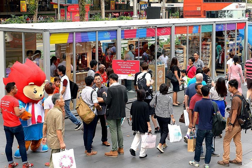 The official 28th SEA Games Merchandise Store along Orchard Road. Held here from June 5-16, itwill run on a budget of $324.5 million, the Singapore SEA Games Organising Committee (Singsoc) announced on Wednesday. -- ST PHOTO:NG SOR LUAN