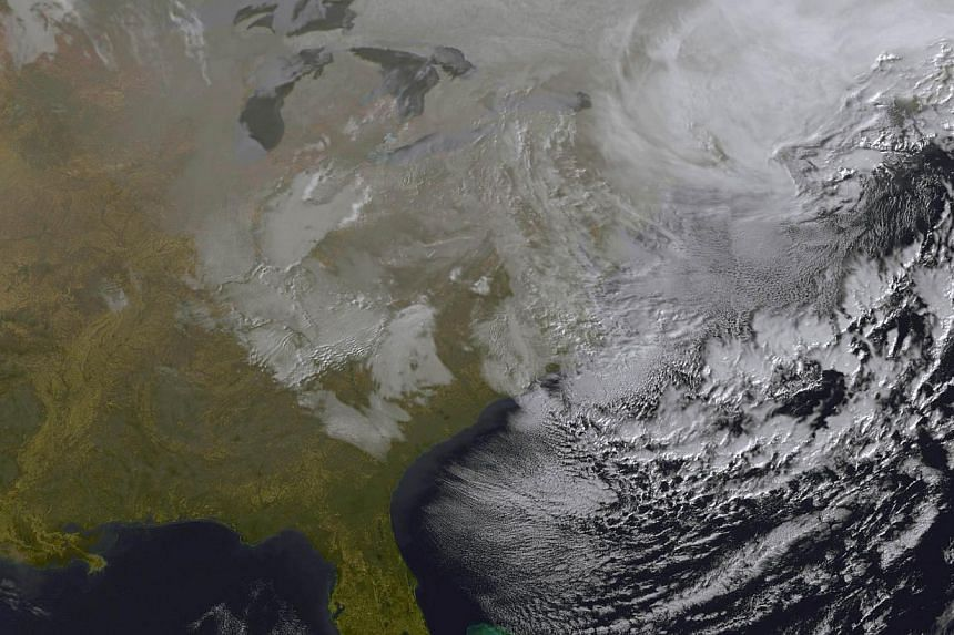 NASA satellite image taken Tuesday showing the winter storm blanketing the northeastern US. -- PHOTO: AFP