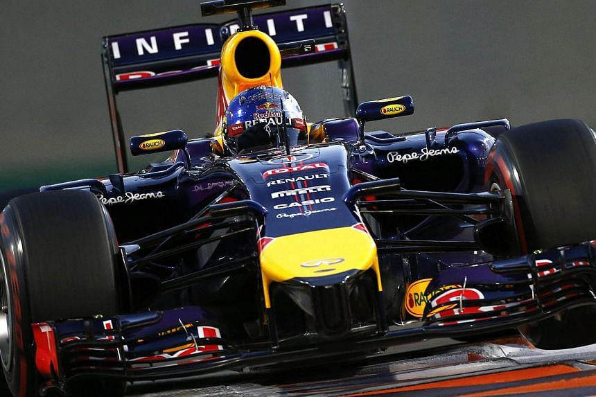 Red Bull Formula One driver Sebastian Vettel of Germany drives during the qualifying session of the Abu Dhabi grand prix on Nov 22, 2014. -- PHOTO: REUTERS