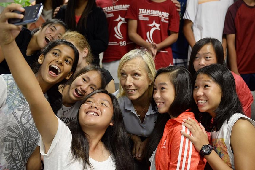 Izabella Tan (holding phone), a junior tennis player with RGS takes a selfie with tennis legend Martina Navratilova and other junior tennis players at the Singapore Sports Institute.International Tennis Hall of Famer Martina Navratilova will re