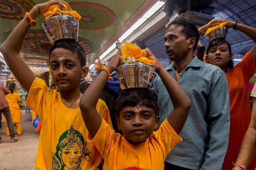 Young children carrying palkudam during the Thaipusam procession on Jan 17, 2014. --PHOTO:TAMIL MURASU FILE