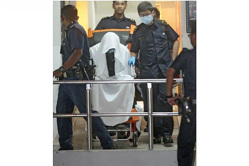 A 26 year-old man was arrested in his home on Thursday morning after an hour-long standoff with police and Singapore Civil Defence Force (SCDF) officers.-- ST PHOTO: SHIN MIN