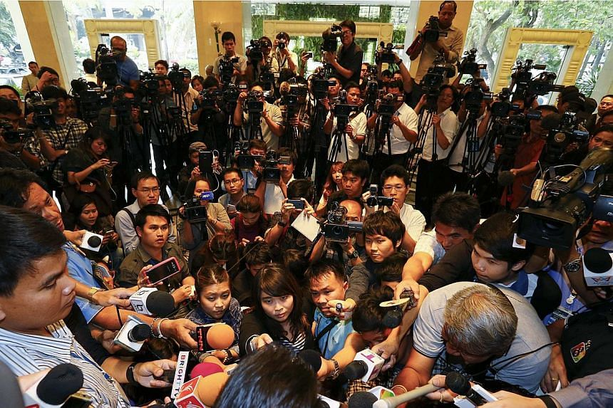 Reporters listening to the Pheu Thai party's legal team making an announcement about ousted prime minister Yingluck Shinawatra, in Bangkok on Jan 23, 2015. A briefing in Thailand by a German rights group on the health of the kingdom's media land