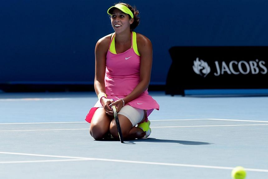 Madison Keys of the USA kneels on the ground as she plays against Serena Williams of the USA during their semifinals match at the Australian Open tennis tournament in Melbourne, Australia, Jan 29, 2015.Making the semi-finals of the Australian O