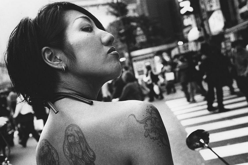 Part of the Shinjuku series by Japanese photographer Daido Moriyama, this black- and-white picture (right) is for sale at the Mad Love exhibition. Critics and audiences have compared Moriyama's personality with the lone, wandering stray dog in one of