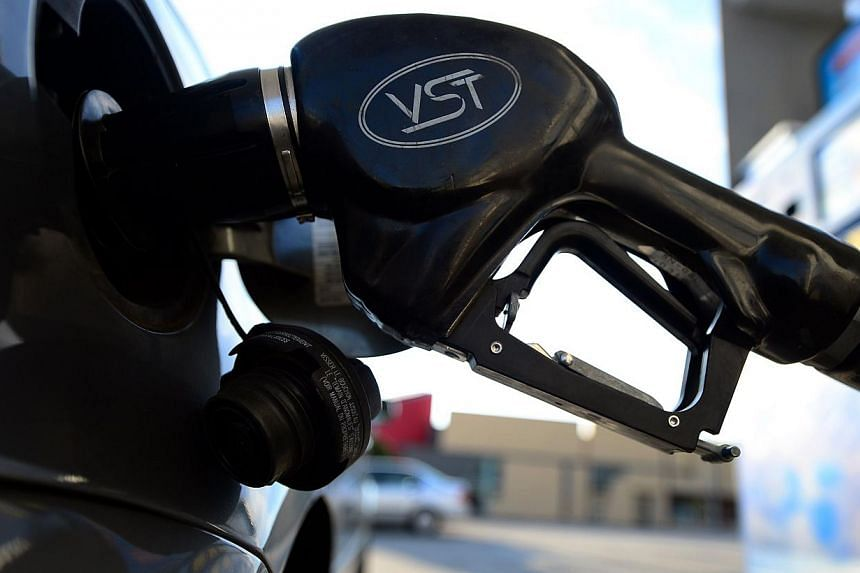 Oil tumbled to near a six-year low on Jan 28, 2015, as US crude stocks soared to a record high, sparking fresh fears over the growing global supply glut. -- PHOTO: AFP