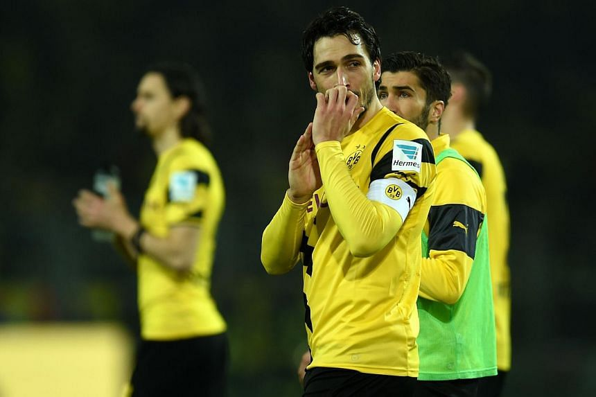 Dortmund's defender Mats Hummels reacts after the German First division Bundesliga football match Borussia Dortmund vs VfL Wolfsburg in Dortmund, Germany, on Dec 17, 2014.Germany centre-back Mats Hummels has played down reports of a planned bid