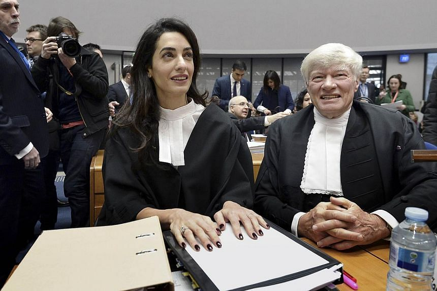 Lawyers representing Armenia, Ms Amal Clooney (left) and Mr Geoffrey Robertson, waiting on Jan 28, 2015, for the start of the appeal hearing before the European Court of Human Rights. -- PHOTO: AFP
