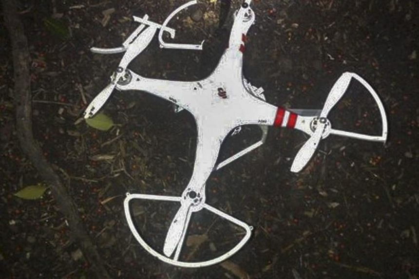 A photograph made available by the US Secret Service shows a recreational quadcopter that reportedly crashed into a tree in the grounds of the White House in Washington, DC on Jan 26 2015. -- PHOTO: EPA
