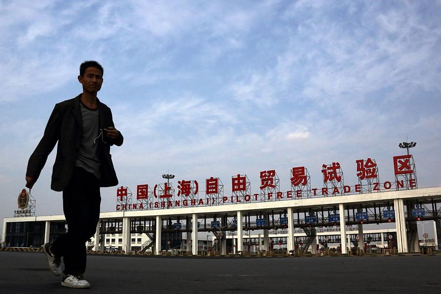 China plans to expand the use of some yuan policies - tested out in the Shanghai Free Trade Zone - to the rest of the country, the State Council said on Thursday, Jan 29, 2015. -- PHOTO: BLOOMBERG