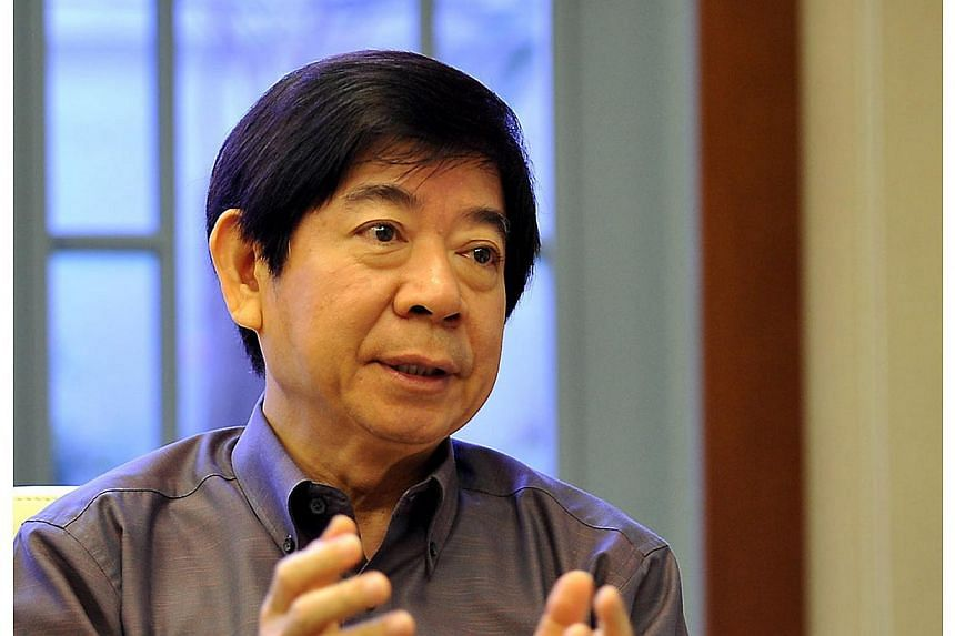 Several Members of Parliament had questions for National Development Minister Khaw Boon Wan, after he announced on Thursday that a place-of-worship site in Sengkang should not have a commercial columbarium. -- PHOTO: ST FILE