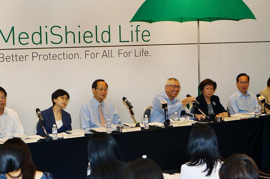 MediShield Life Review Committee chairman Bobby Chin (fourth from left) with members of the committee speaking during apress conference held at the Suntec City Convention Centre on June 27, 2014. -- PHOTO: LIANHE ZAOBAO FILE