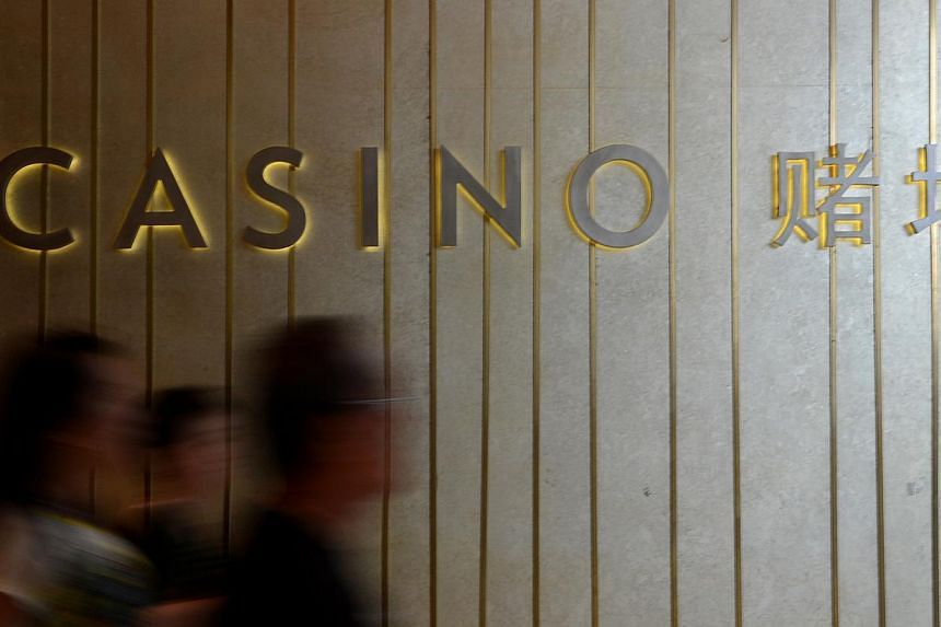 People walking past the casino at Marina Bay Sands. Las Vegas Sands Corp., the world's largest casino operator, posted fourth-quarter earnings that beat analysts' estimates as profit in Singapore doubled. -- ST PHOTO: MUGILAN RAJASEGERAN