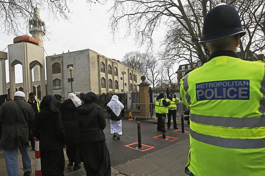 Police carry out a regular patrol as worshippers arrive at the London Central Mosque at Regent's Park in London Jan 9, 2015. British mosques are to throw their doors open to the general public, it was announced on Wednesday, in a bid to reach out to