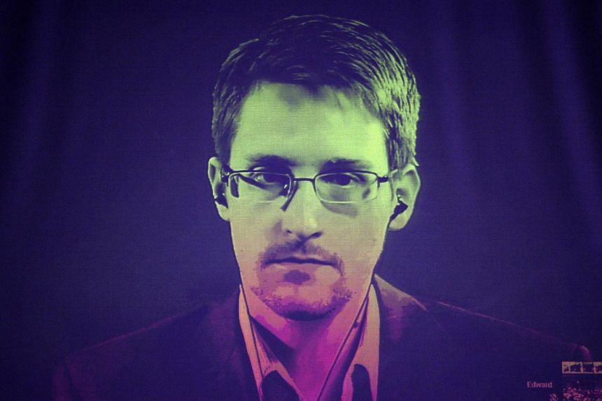 Documents obtained by US whistleblower Edward Snowden (above) reveal that Canada's electronic spy agency has been intercepting and analysing data on up to 15 million file downloads daily as part of a global surveillance programme. -- PHOTO: AFP