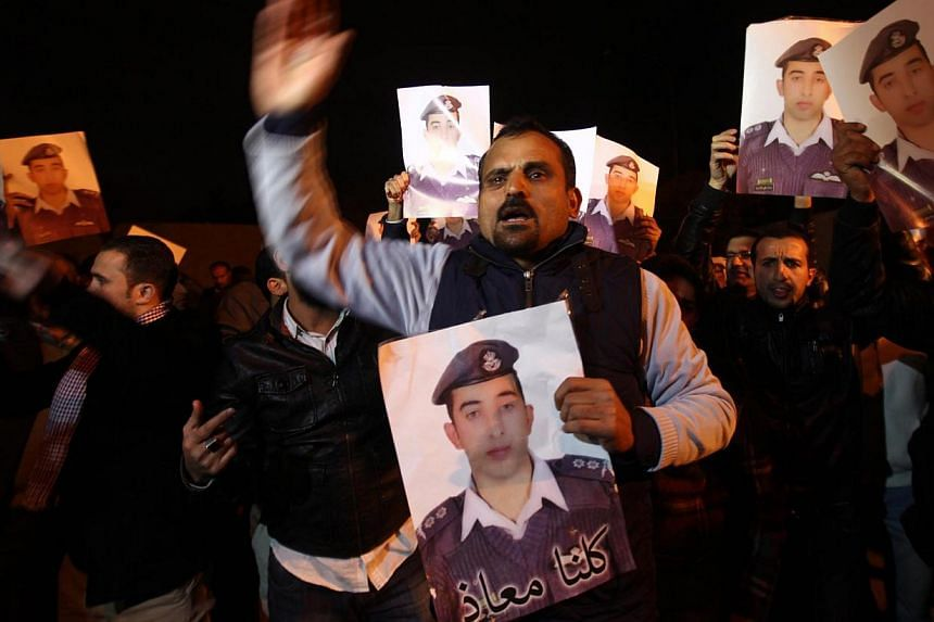 Relatives of Jordanian pilot Muath al-Kasaesbeh, who was captured by Islamic State militants in Syria, protesting in front of Royal palace in Amman, Jordan on Jan 28, 2015. -- PHOTO: EPA