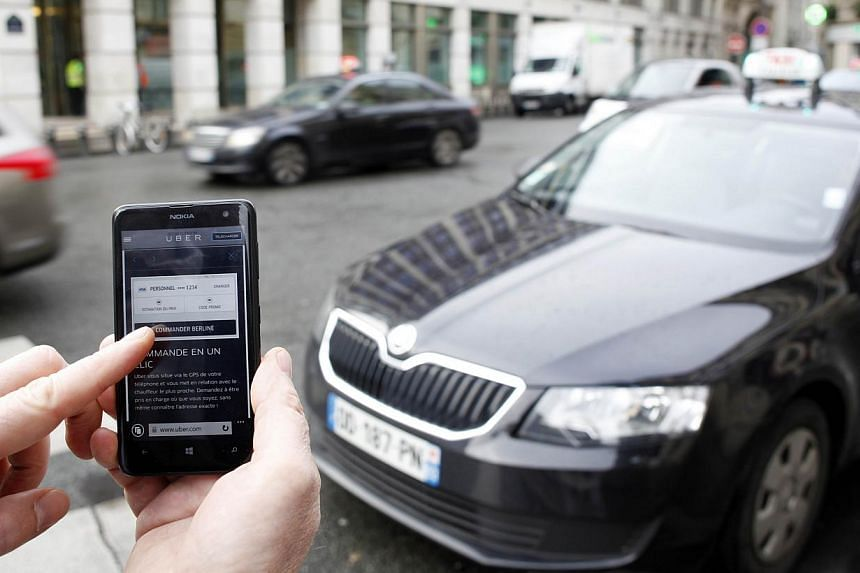 A picture shows the Uber smartphone app, used to book taxis using its serviceon Dec 10, 2014 in Paris. -- PHOTO: AFP