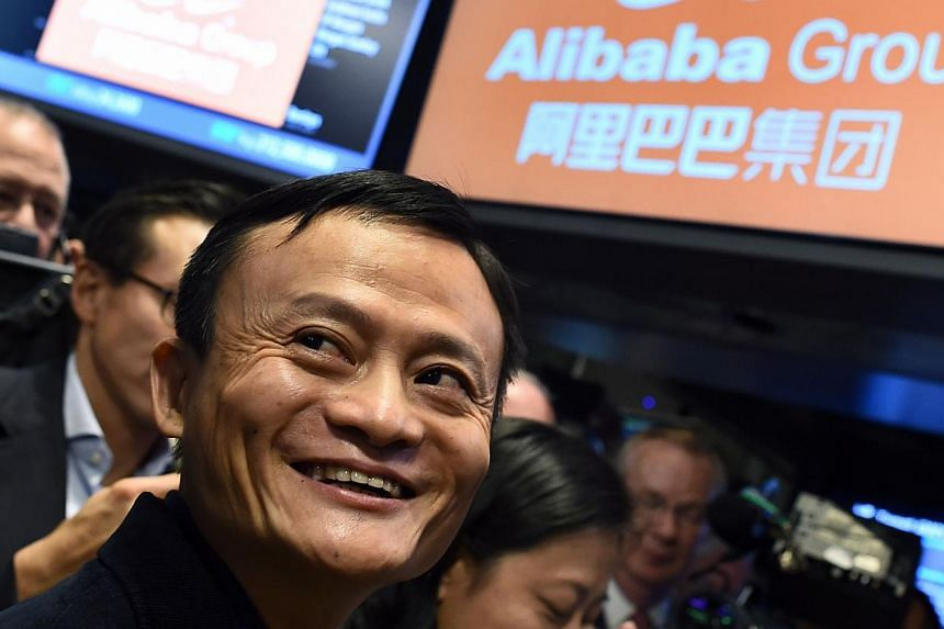 Alibaba founder Jack Ma waiting for trading to open at the New York Stock Exchange on Sept 19, 2014, the day the company was listed. -- PHOTO: AFP