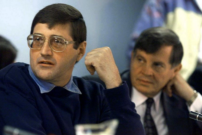 Apartheid death-squad leader Eugene de Kock (left) appears before the Truth And Reconciliation Commission (TRC) amnesty hearing with his lawyer Schalk Hugo in Pretoria in this May 24, 1999 file photo. -- PHOTO: REUTERS