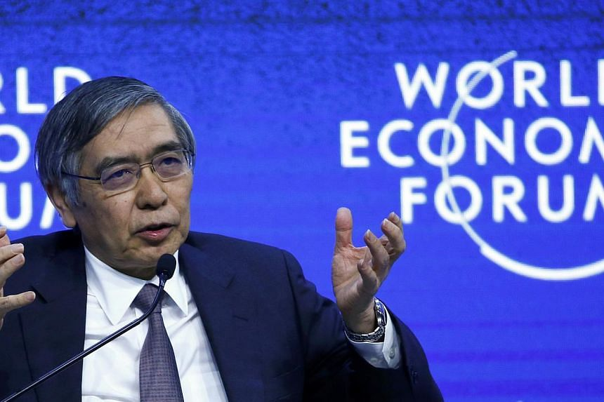 Haruhiko Kuroda, Governor of the Bank of Japan, speaking at the World Economic Forum in Davos on Jan 24, 2015. The Bank of Japan has put monetary policy on hold and found backing for its wait-and-see stance. -- PHOTO: REUTERS