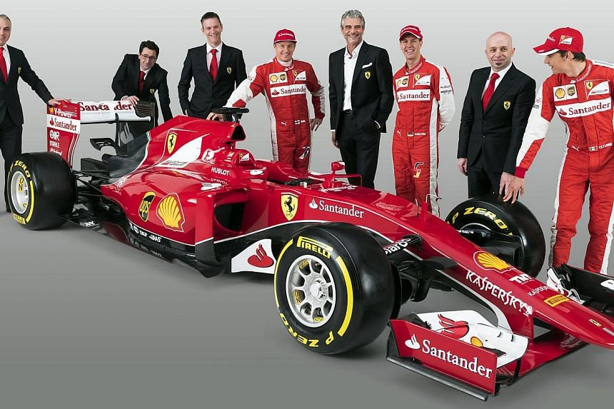 This handout picture released on Jan 30, 2015, by the Ferrari press office shows (from left) production director Corrado Lanzone, business profile as chief operating officer Mattia Binotto, designer, engineer, and current technical director James All