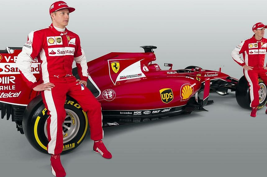 This handout picture released on Jan 30, 2015, by the Ferrari press office shows the new Formula 1 of the team Ferrari, the FS15-T with pilots Kimi Raikkonen (left) and Sebastian Vettel (right) during its launching in Maranello. -- PHOTO: AFP