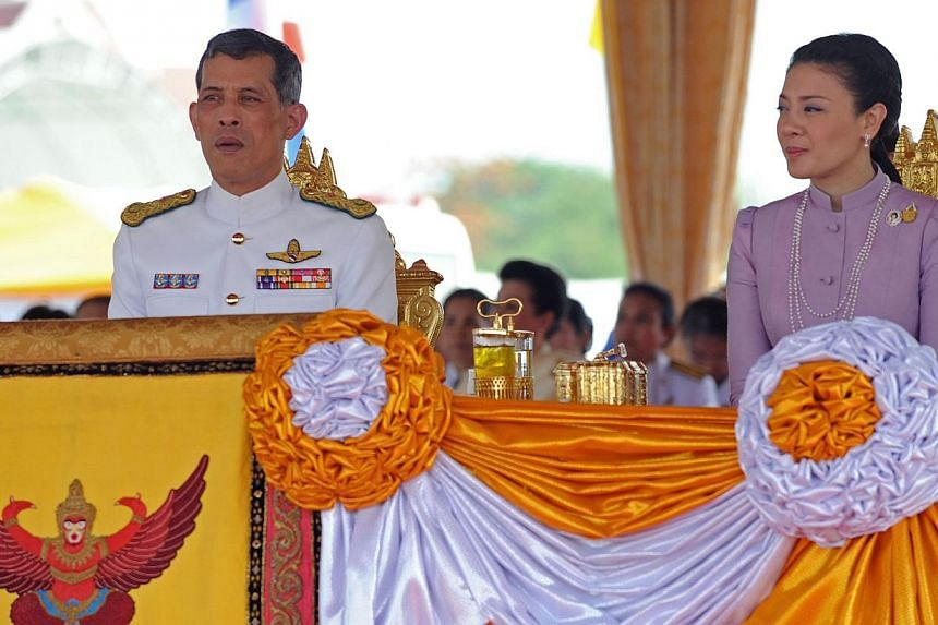 This file picture taken on May 13, 2010 shows Thai Crown Prince Maha Vajiralongkorn (left) and Princess Srirasmi (right) as they attend the annual Royal Ploughing Ceremony at Sanam Luang in Bangkok. Two senior Thai police officers allegedly at t