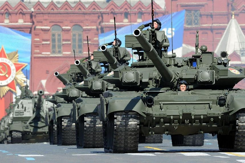 A file photo taken on May 9, 2013, shows a column of Russia's T-90 tanks rolling at the Red Square in Moscow, during Victory Day parade. The chief of Russia's armed forces said on Friday a strong nuclear arsenal will ensure military superiority over