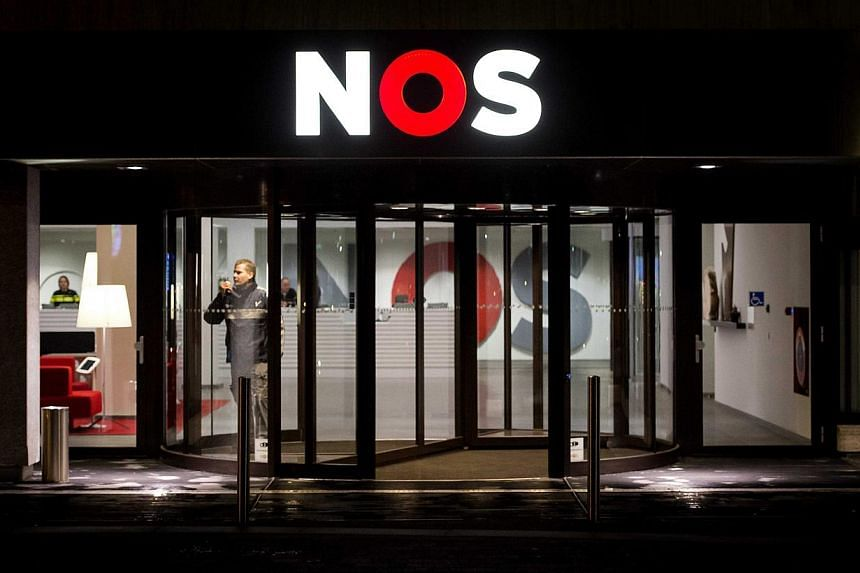 Extra security guards at the entrance of the offices of Dutch television broadcasting organization NOS the morning after an alleged gunman was arrested for disrupting the evening news, at the Media Park in Hilversum, the Netherlands on Jan 30, 2015.&