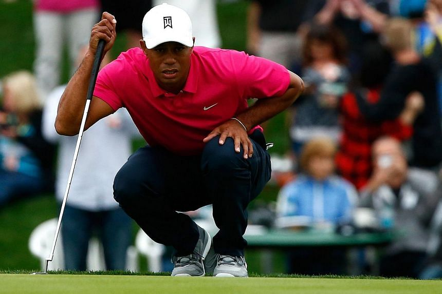 Tiger Woods assesses a putt on the 17th green during the first round of the Waste Management Phoenix Open at TPC Scottsdale on Jan 29, 2015, in Scottsdale, Arizona.While Tiger Woods struggled in his first PGA Tour start of the season, Ryan Palm