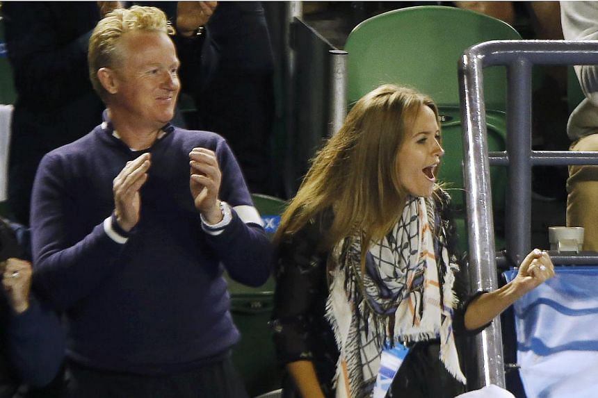 Kim Sears (right), fiancee of Andy Murray of Britain, celebrates after he defeated Tomas Berdych of Czech Republic in their men's singles semi-final match at the Australian Open 2015 tennis tournament in Melbourne on Jan 29, 2015.Andy Murray ha