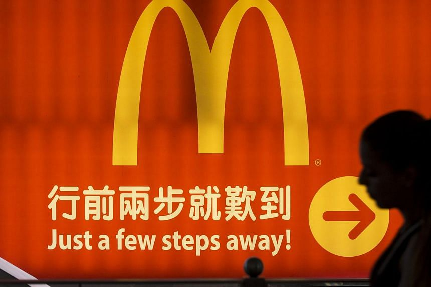 US fast food giant McDonald's has served up a super-sized order of controversy by proposing a branch in a historic building in one of China's most frequently painted landscapes, Hangzhou's West Lake. -- PHOTO: REUTERS