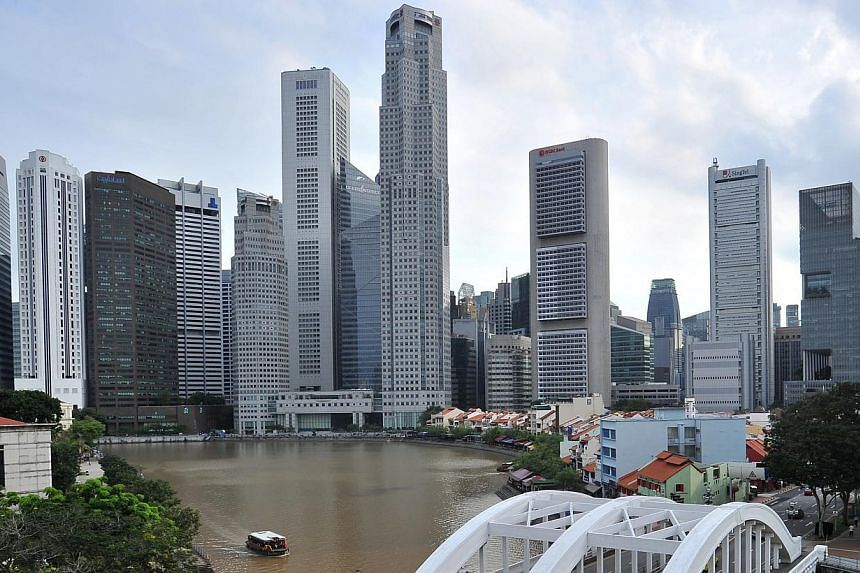 Singapore's Big Three local banks should be able to weather a significant rise in credit costs given their healthy loss-absorption buffers, says Fitch Ratings. -- PHOTO: ST FILE