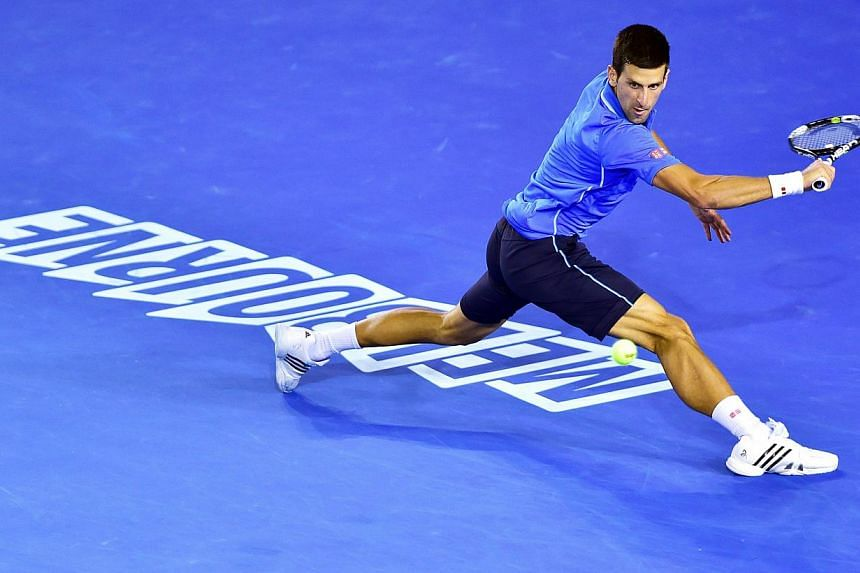 Novak Djokovic of Serbia returns the ball to Stanislas Wawrinka of Switzerland during their semi final match at the Australian Open Grand Slam tennis tournament at Melbourne Park in Melbourne, Australia on Jan 30, 2015. Top seed Novak Djokovic e