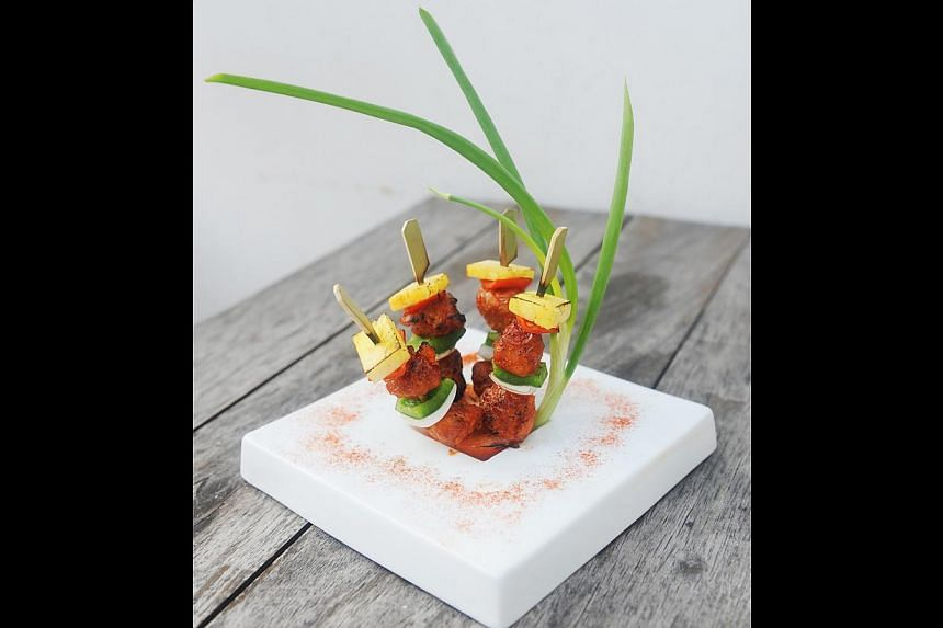 Aigre-Doux, a play on sweet and sour pork served on skewers. -- PHOTO: TIFFANY GOH