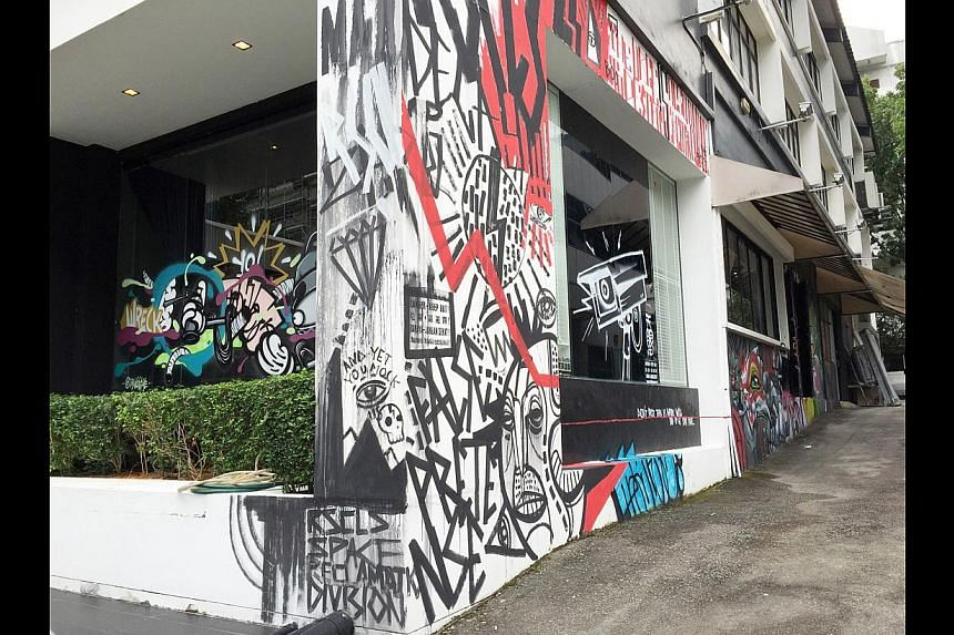 Art (above) by graffiti collective RSCLS on the exterior of The Mill in Jalan Kilang. -- ST PHOTO: NABILAH SAID