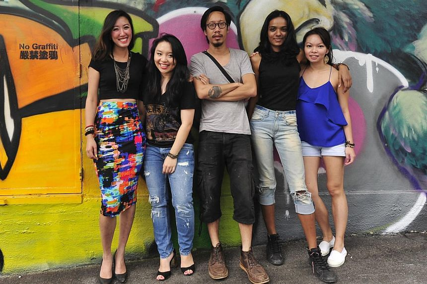 Curators and organisers of Destruction & Rebirth include (from left) The Mill's Low Shu Min, 28, Gabrielle Chia, 23, Spencer Chan, 31, Vedika Saxena, 25, and May Leong, 33. -- PHOTO: DIOS VINCOY JR FOR THE STRAITS TIMES