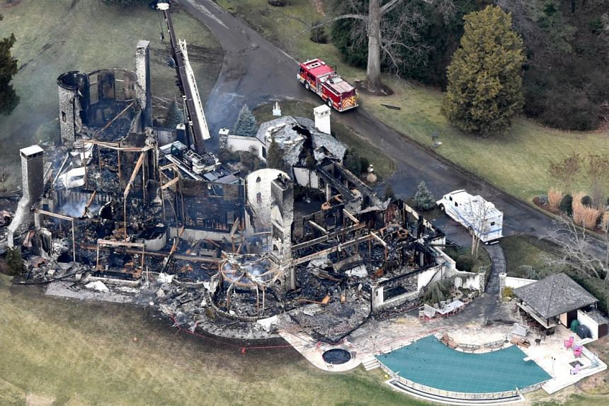 The 16,000 sq ft house in Annapolis, Maryland, was destroyed in the Jan 19 fire, which was fuelled by a dry Christmas tree. The fire claimed the lives of owners Don and Sandra Pyle, andtheir four grandchildren. -- PHOTO: GETTY IMAGES