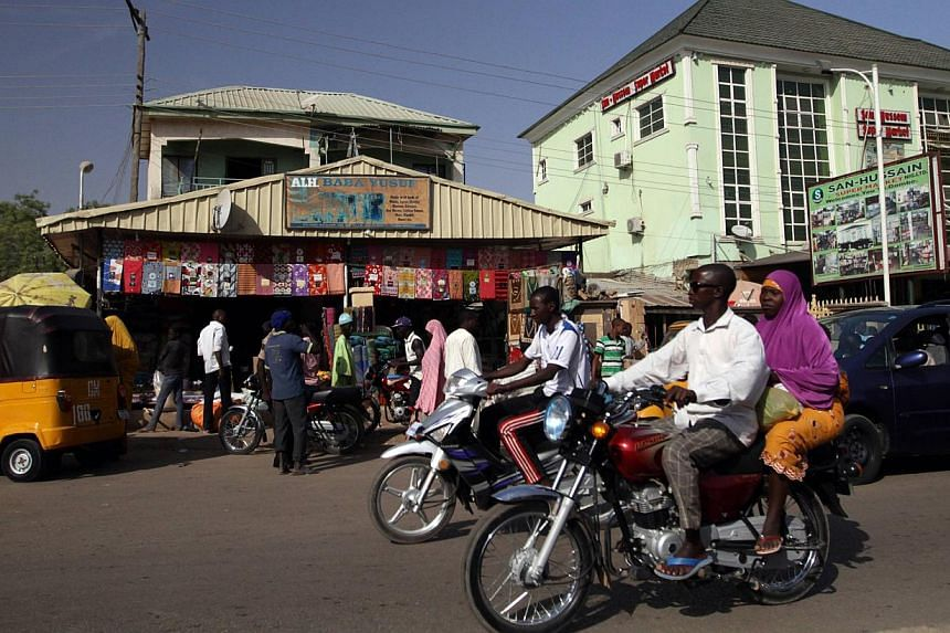 People ride on motorcycles on a street in the northeast Nigerian city of Gombe, which has been recently targeted by Boko Haram militants with bombs and attacks, on Jan 29, 2015. -- PHOTO: REUTERS