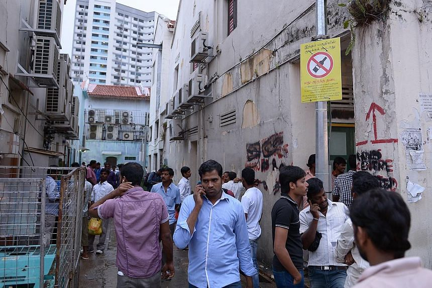 """A sign saying """"no alcohol"""" adorns a lamppost lining the streets and back alleys Race Course Road and Kerbau Road. Ms Denise Phua (Moulmein-Kallang GRC), who looks after a part of Little India, made an impassioned speech on the need to have strict"""