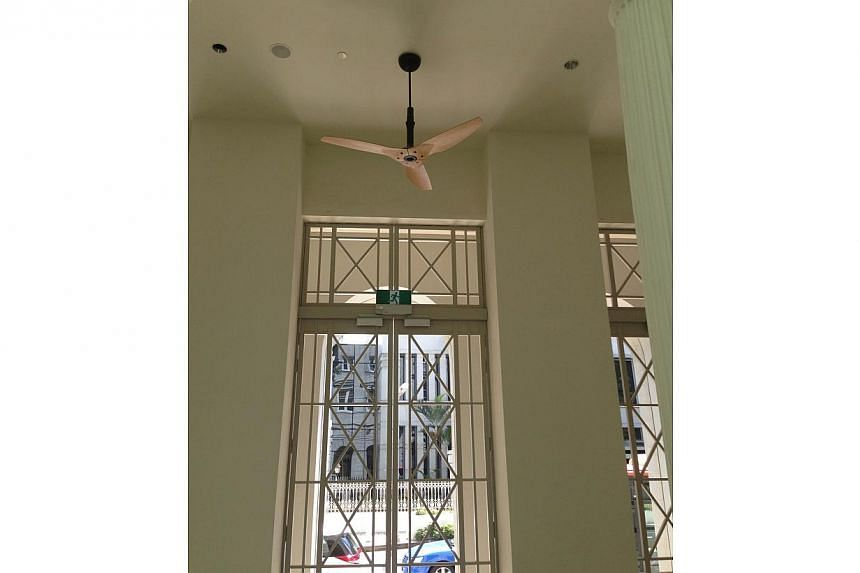 Extensive care has been taken by the architects to maintain the building's historic interiors while adding fixtures to meet modern building codes. This is apparent even in the additions such as lighting and fans. -- ST PHOTO: DEEPIKA SHETTY